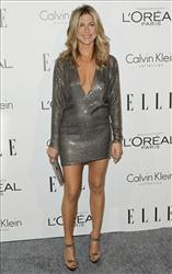 Actress Jennifer Aniston arrives at the 18th Annual ELLE Women in Hollywood celebration in Beverly Hills, Calif., Monday, Oct. 17, 2011.  The dinner celebrates women's achievements in film.