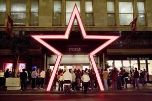 Shoppers stand outside Macy's San Francisco store on Black Friday.