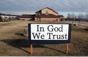 A sign that reads In God We Trust is pictured outside the Central Valley Baptist Church on Tuesday, Feb. 9, 2010 in Meridian, Idaho.