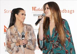 Kim Kardashian and Khloe Kardashian speak to fans during a promotion for the Kardashian Kollection Handbag range at Westfield Miranda on November 3, 2011 in Sydney, Australia.