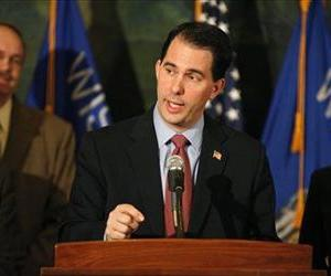 Wisconsin Gov. Scott Walker talks about his plans to strip unions of their collective bargaining rights in this Feb 11, 2011 file photo.
