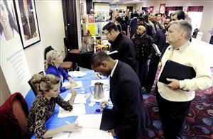 Job seekers attend the Minneapolis Career Fair held Wednesday, Nov. 2, 2011, in Bloomington, Minn.