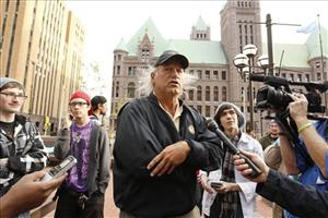 In this Oct. 7 photo, former Minnesota Gov. Jesse Ventura talks to the media while appearing at the Occupy Minnesota demonstration at the Hennepin County Government Plaza in Minneapolis.