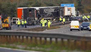 A view of the scene on the M5 motorway close to Taunton in southwestern England Saturday Nov. 5, 2011, following a 27 vehicle pile-up late Friday.