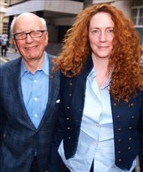 A file picture taken on July 10, 2011, shows Rebekah Brooks, former chief executive of News International, and Rupert Murdoch in London.