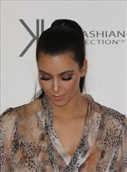 Kim Kardashian arrives at a promotion for the Kardashian Kollection Handbag range at Westfield Miranda on November 3, 2011 in Sydney, Australia.