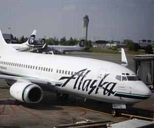 An Alaska Airlines jet is seen at SeaTac Airport in SeaTac, Wash., in this file photo.