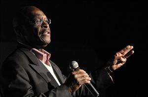 Herman Cain speaks to an overflow crowd at Streeters Nightclub in Traverse City, Michigan yesterday.