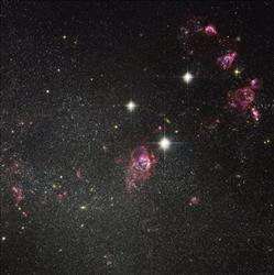 The  NASA/ESA Hubble Space Telescope has captured this image released Thursday Sept. 29, 2011 of dwarf  irregular galaxy Holmberg II.