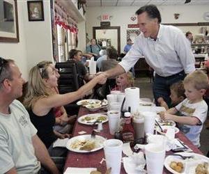Mitt Romney shakes hands with people at Farm Boys restaurant during a visit in May to Chapin, SC.