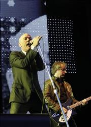 In this July 15, 2008 file photo, REM with singer Michael Stipe, left, and guitarist Peter Buck, right, perform at an open air concert in Dresden, eastern Germany.