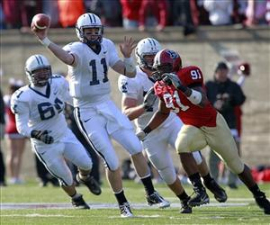 Yale Bulldogs QB Patrick Witt makes a pass as he is chased out by Harvard Crimson defensive end Victor Ojukwu on Saturday, November 20, 2010 in Cambridge, Mass.