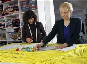 German fashion designer Anke Domaske, right, and seamstress Tatjana Berthold work at their studio in Hannover, Germany.
