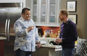 In this publicity image released by ABC, Eric Stonestreet, left, and Jesse Tyler Ferguson are shown in a scene from Modern Family.