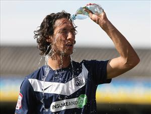 Bilel Mohsni of Southend United pours a bottle of water over his head during a match on September 3, 2011 in Southend, England.