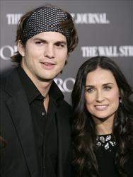 In this May 22, 2007 file photo, actors Ashton Kutcher, left, and Demi Moore arrive at the premiere of Mr. Brooks in Los Angeles.