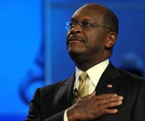 GOP presidential hopeful Herman Cain listens to the National Anthem prior to the start of the Republican presidential debate on national security November 22, 2011.