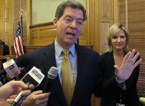 Kansas Gov. Sam Brownback: his aides tattled on Emma.
