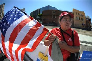 An immigrant woman marches to demand legalization for all immigrants in Los Angeles on May 1, 2011.