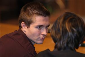 Raffaele Sollecito waits in Perugia's Court of Appeal before hearing that his murder conviction had been overturned.