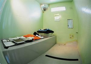 In this image released by the US Military Joint Task Force Guantanamo, the interior of a cell from a disciplinary block known as Five Echo is pictured with a wide-angle lens.