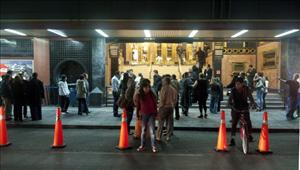 People remain outside on December 10, 2011 after an eartquake in Mexico City.