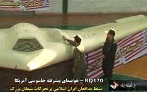 Iran shows off what it says is a US drone in this screenshot from its state-run TV station.