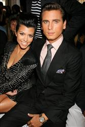 Kourtney Kardashian and Scott Disick attend the showing of the Jill Stuart spring 2011 collection during Mercedes-Benz fashion week in New York, Saturday, Sept. 11, 2010.