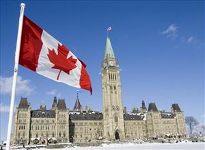 A Canadian Flag flies over Parliament Hill in Ottawa Friday, Feb. 15, 2008. It is the 43rd anniversary of the creation of the Canadian flag.