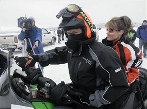 Todd Palin drives his wife Sarah to the starting line of the Iron Dog snowmobile race.
