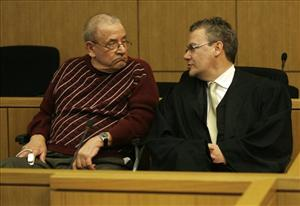 Former member of Hitler's Waffen SS Heinrich Boere, left, sits next to lawyer Gordon Christiansen during his trial in the courtroom of the court in Aachen, Germany, March 23, 2010.