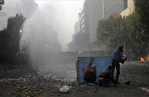 Egyptian military police use a water cannon against protesters during clashes near Tahrir Square Saturday.