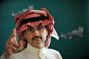 Prince Alwaleed bin Talal, the Saudi billionaire owner of Kingdom Holding Company,  gestures during a press conference in Riyadh.