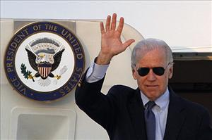 US Vice President Joe Biden waves upon arrival at Eleftherios Venizelos airport in Athens on December 4, 2011.