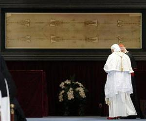 Pope Benedict XVI leaves San Giovanni cathedral after praying in front of the Holy Shroud, seen in the background, in Turin, Italy, Sunday, May 2, 2010.