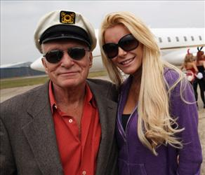 Playboy founder Hugh Hefner and Crystal Harris arrives at Stansted Airport on June 2, 2011 in Stansted, England.