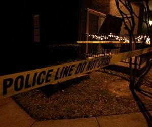 Police line tape surrounds an apartment building where seven people were found dead at Lincoln Vineyard Apartment Homes on December 25, 2011 in Grapevine, Texas.