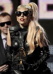 In this Feb. 13, 2011 file photo, Lady Gaga accepts the award for best pop vocal album at the 53rd annual Grammy Awards in Los Angeles.