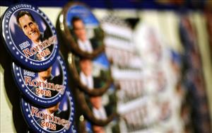 Mitt Romney pins on display at a coffee shop during a campaign stop in Muscatine, Iowa.