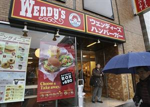 A man walks by a Wendy's hamburger chain restaurant in Tokyo, Japan, Friday, Dec. 11, 2009.