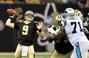 New Orleans Saints quarterback Drew Brees passes as Carolina Panthers defensive tackle Jason Shirley rushes during the second quarter of an NFL football game in New Orleans, Sunday, Jan. 1, 2012.