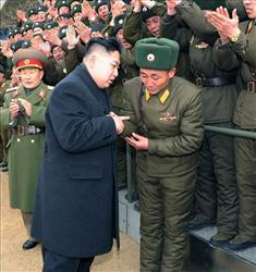 Kim Jong Un shakes hands with a soldier during an inspection at Seoul Ryu Kyong Su 105 Guards Tank Division of the Korean People's Army in North Korea to congratulate service members.