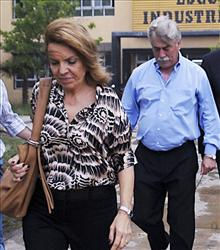 Susana Soria is followed by her husband Carlos Soria, governor of Rio Negro. Susana is being questioned after Soria, 62, who had just taken office on Dec. 9, was shot to death yesterday.