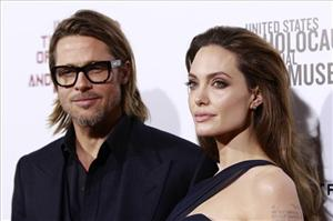 Brad Pitt, left, and Angelina Jolie, writer and director of the film In the Land of Blood and Honey pose at the premiere in Los Angeles, Thursday, Dec. 8, 2011.