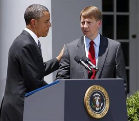 In this July 18, 2011 file photo, President Barack Obama shakes hands with former Ohio Attorney General Richard Cordray.
