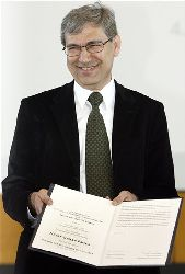 Orhan Pamuk, Turkish writer and Nobel prize for literature laureate, smiles after he was awarded an honorary doctorate of the Free University of Berlin, Germany, Friday, May 4, 2007.