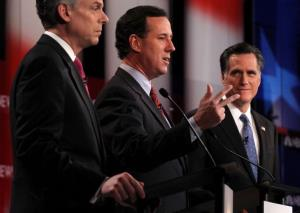 Jon Huntsman, Rick Santorum, and Mitt Romney participate during the NBC News Facebook Debate on 'Meet the Press' January 8, 2012, at the Capitol Center for the Arts in Concord, New Hampshire.