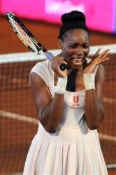 Venus Williams reacts after defeating her sister Serena Williams  during an exhibition tennis match in Medellin, Colombia last fall.