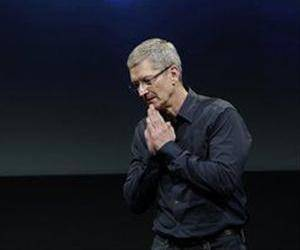 In this Oct. 4, 2011 file photo, Apple CEO Tim Cook gestures during the introduction of the iPhone 4S, at Apple headquarters in Cupertino, Calif.