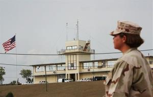 A U.S. Navy personnel patrols at Gitmo in this file photo.